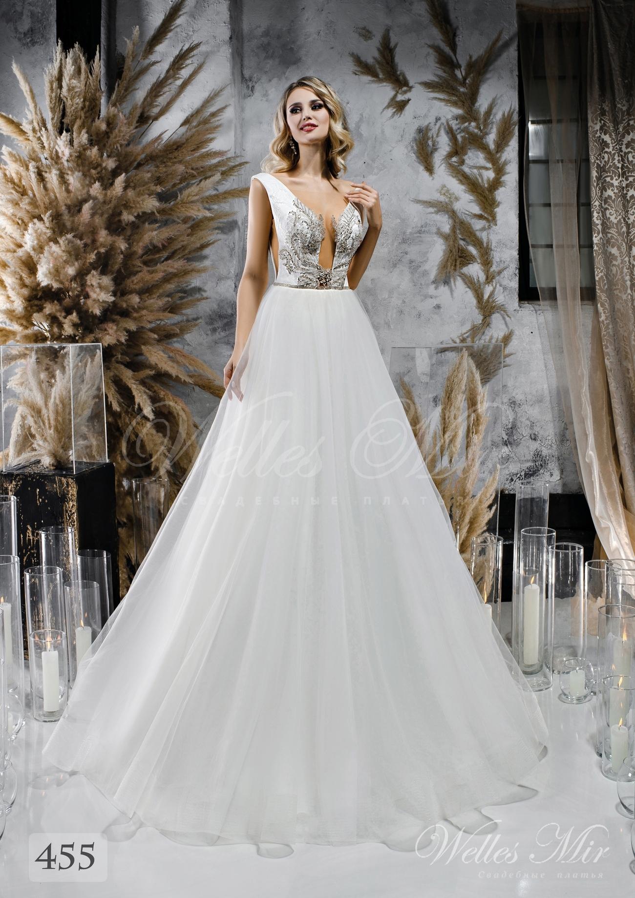 Весільну сукню з пишною спідницею і розколотим корсетом оптом від WellesMir